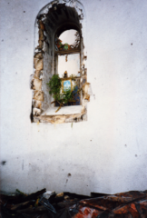 Someone puts an image of Our Lady in a bombed-out window