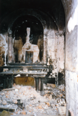 the destroyed altar in the church of Sts. Peter and Paul in Mostar during the war